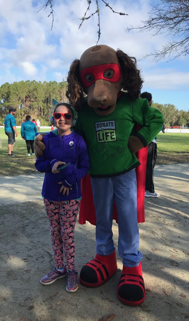 Mary Ashley poses with Chance The Donor Dog at the 2018 Sharing Hope Race for Life in James Island, SC