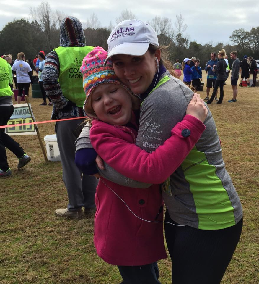 Taylor and Mary Ashley hugging at the finish line