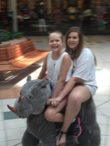 Mary Ashley and Allison ride around in the mall.